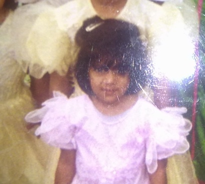 Can you see that look of scepticism in my face? My sisters (behind) had the same frilly dresses as me in yellow, which were our mum put on us for special occasions.