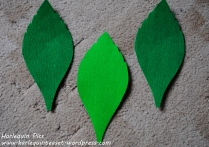 Lastly secure the leaves onto the flower, you can stick them on floral wire with floral tape and then bind them to the step. Use crepe paper on the whole stem to hide the glue marks and make it neater.