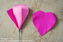 Once all the teardrops have been used up, use the heart shape pertal and wrap this from the base of the flower bud and secure.