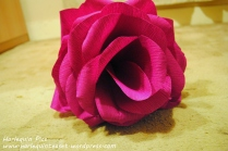 Your flower should now be taking shape and becoming fuller, keep securing the petals with floral tape and glue.